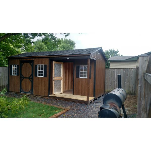 10x18 Workshop with Corner Porch - Brown with Green Trim
